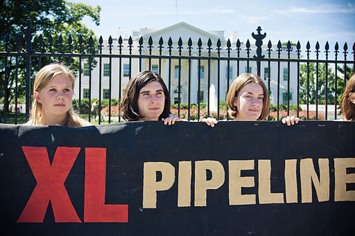 Protesters stand in front of the Whitehouse protesting the Keystone XL pipeline.