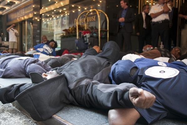 Protestors staged a die-in outside of the Palmer House Hilton where ALEC held is annual meeting (Source: Progress Illinois)