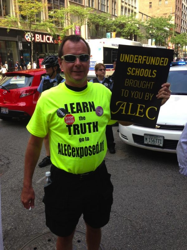 "Man wearing t-shirt with ""Learn the Truth, go to ALECexposed.org"" (Source: Nick Surgey)"