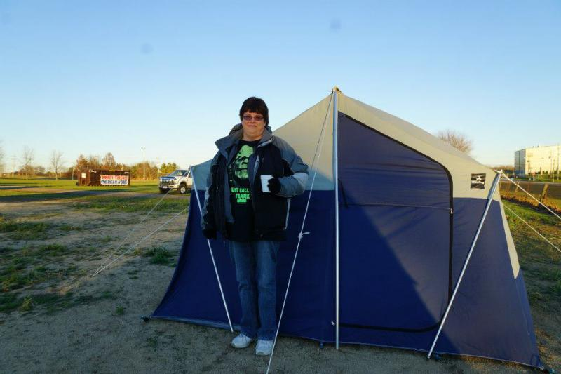 Bonnie Borman standing outside of her tent in Bainport (Source: Leslie Peterson)