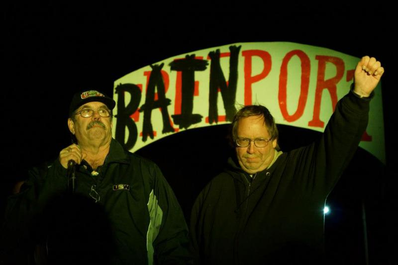 USW President Leo Gerard and Sensata worker Tom Gaulrapp on stage in front of Bainport sign