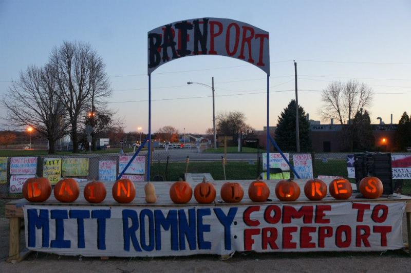 image of the stage at Bainport with pumpkins that spell out Bain Vultures and sign that says Mitt Romney: Come to Freeport