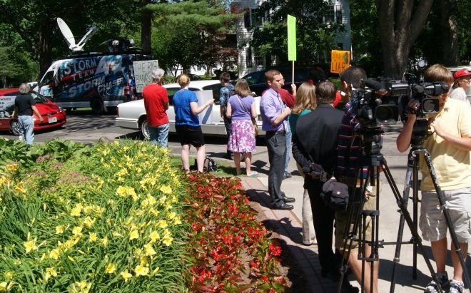 Press and protestors outside the governor's mansion (source: Leslie Peterson)