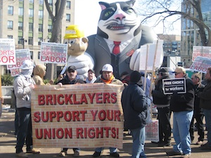 Bricklayers Union with Fat Cat balloon - the Fat Cat has 'Koch Brothers' on his lapel and is squeezing a little guy with 'Wisconsin Workers' on his hard hat.