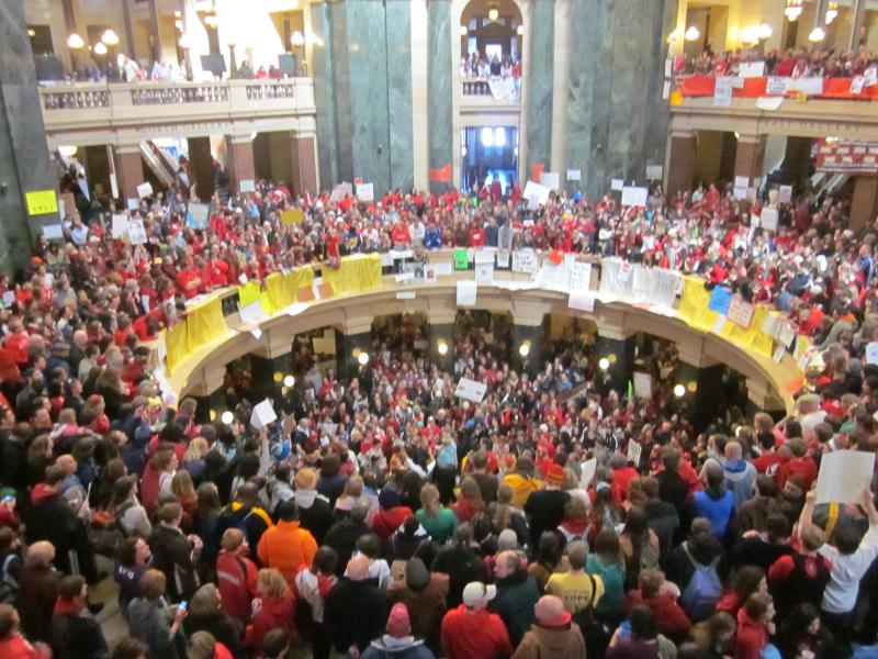 Wisconsin state capitol rotunda packed with protestors