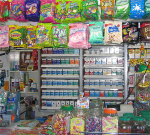 Cigarette retail 'power wall' surrounded by candy