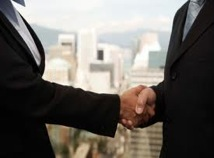 picture of two men in suits shaking hands