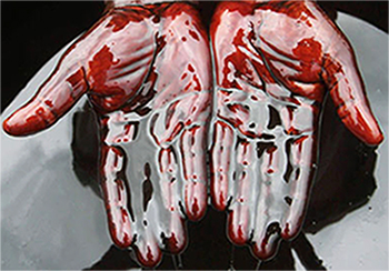 hands covered in crude oil