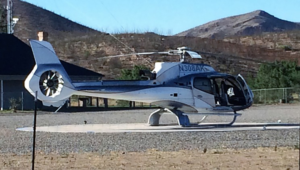 Helicopter owned by Howard Buffett parked on helipad in front of Christiansen compound, June 2016. (Photographer asked to remain anonymous)
