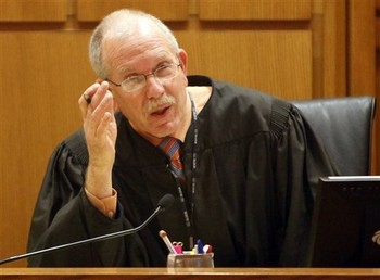 Judge John C. Albert presides over a hearing at the Dane County Courthouse (Photo courtesy of AP)