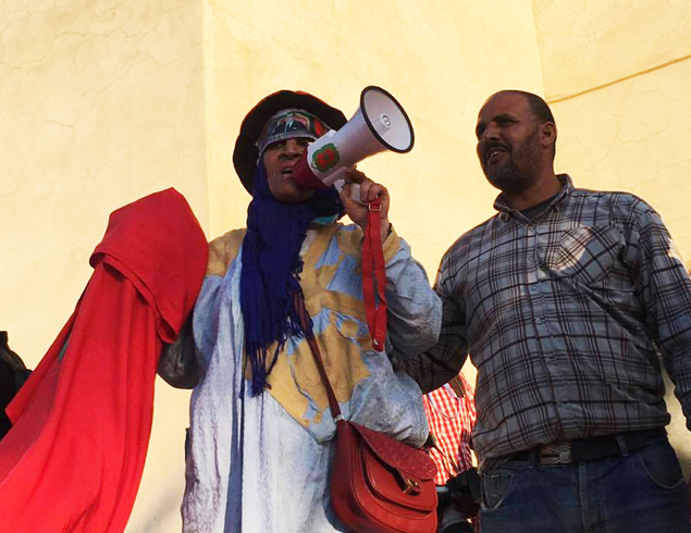 Many groups in Marrakech, Morocco, assemble and make speeches.