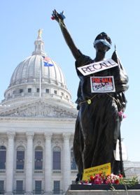Signs adorning Miss Forward outside of the Wisconsin State Capitol yesterday (Photo by Lynn Welch)