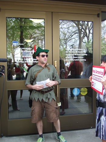 Reverse Robin Hood Mike Amato speaks in front of M&I