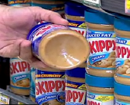 "Skippy peanut butter jars now have an inward ""dimple"" on the bottom to reduce the amount they hold. (Source: CNN)"
