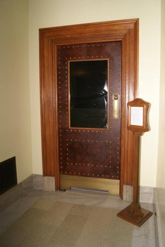Door to the Assembly gallery with black plastic over the window (Source: Leslie Peterson)