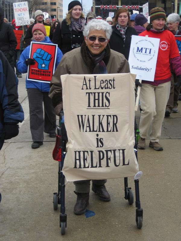 At Least This Walker Is Helpful protest sign