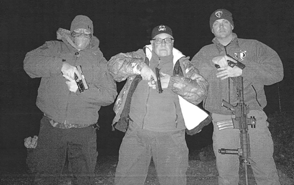Howard Buffett (center) and friends posing for an IPhone photo near the Mexican border. (Courtesy of Decatur Police Department)