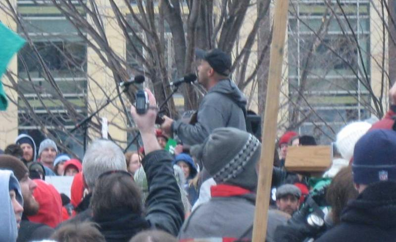Tom Morello, the Nightwatchman, performs at rally in Madison