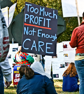 Too Much Profit, Not Enough Care sign