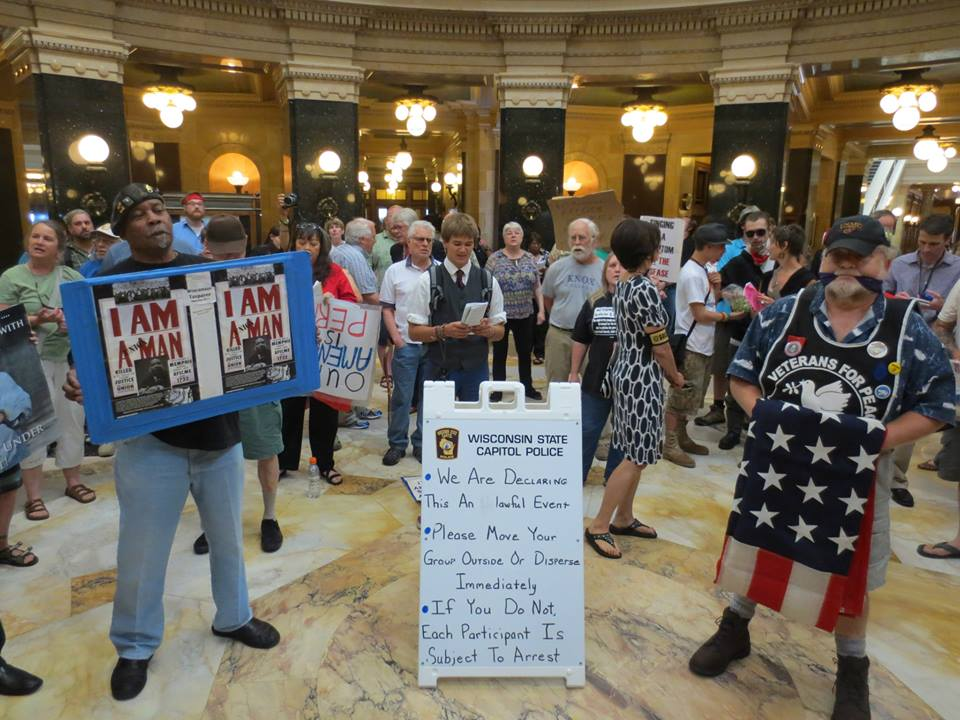 Veterans For Peace stand tall in the Wisconsin Capitol rotunda