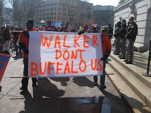 The private-sector Laborers Union marched in with a buffalo head and an eloquent sign