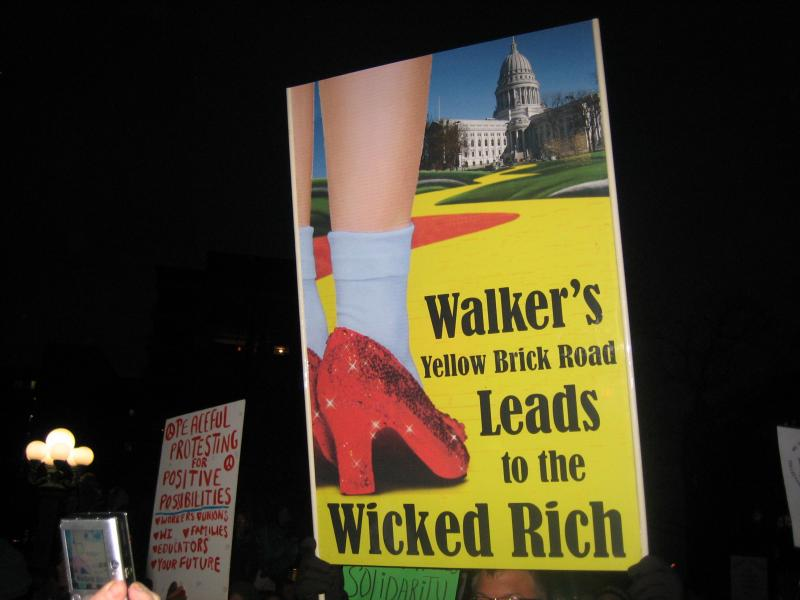 Walker's Yellow Brick Road Leads to the Wicked Rich protest sign