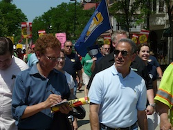 Former U.S. Senator Russ Feingold leads the march down State St
