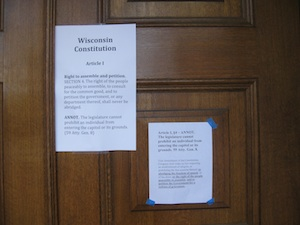 A copy of the Wisconsin Constitution's provisions on open government was posted on the doors of the Capitol when reporters arrived early this morning
