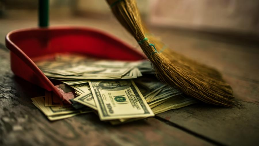Broom sweeping money