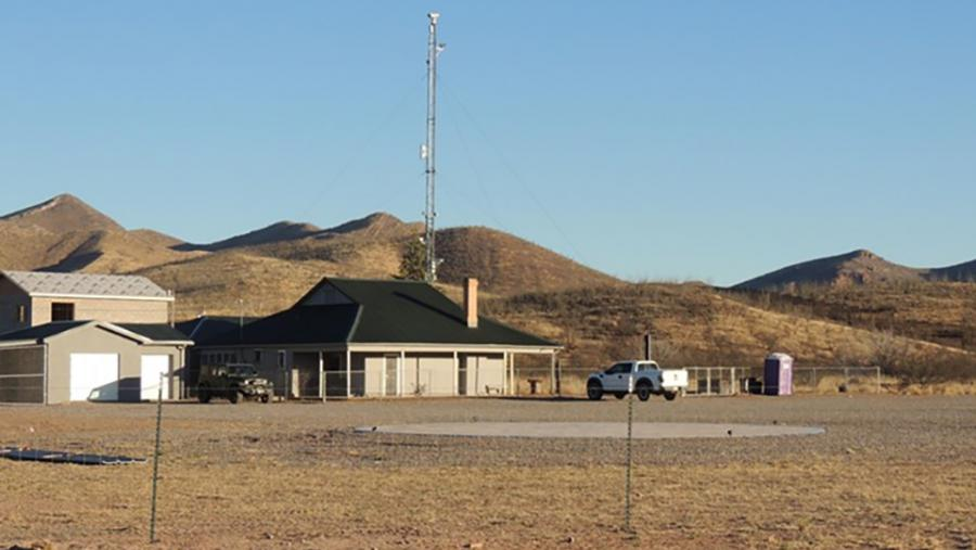 Howard Buffett's Christiansen Ranch, reminiscent of a paramilitary compound, is about 300 yards from the border wall. (Beau Hodai)
