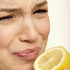 Image of woman with sour face from lemon